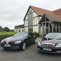 2 wedding limos at Sandburn Hall